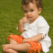 Little girl on grass — Stock Photo