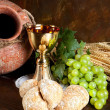 Jug of wine and communion bread — Stock Photo