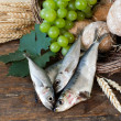 Holy bread with basket of fish — Stock Photo