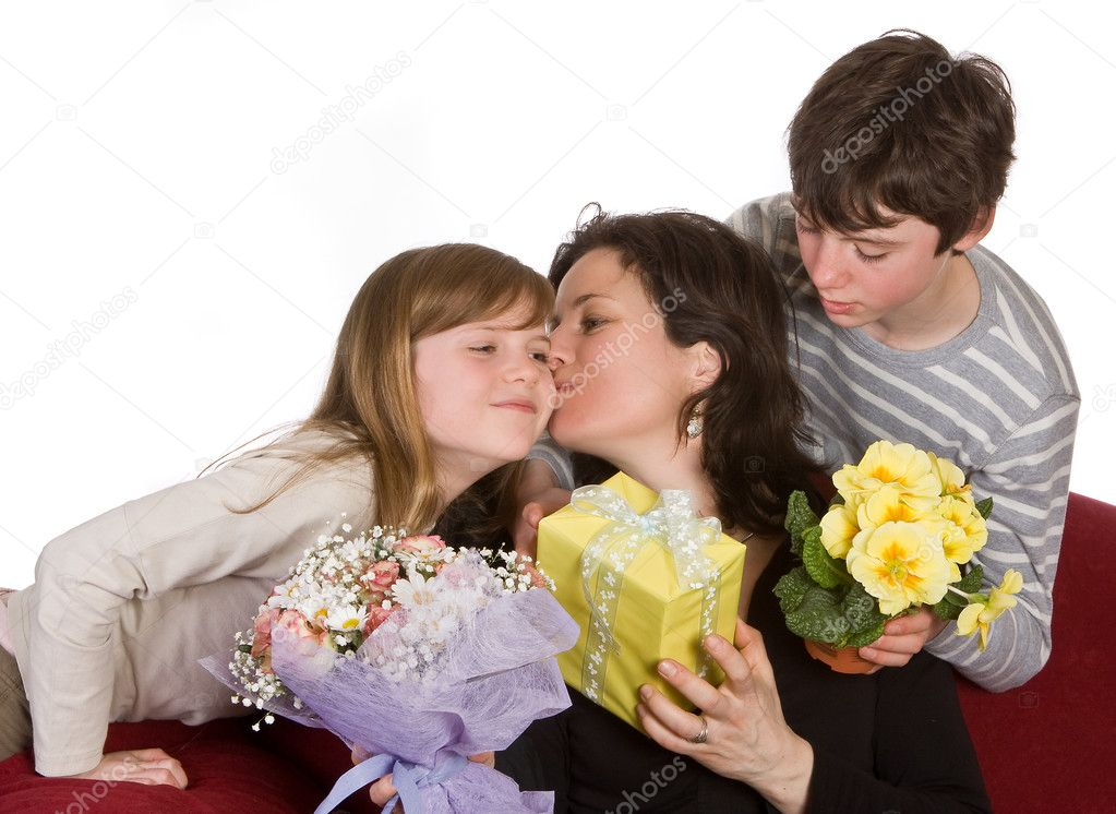 Mother kissing her daughter on mother's day  Stock Photo #9805262
