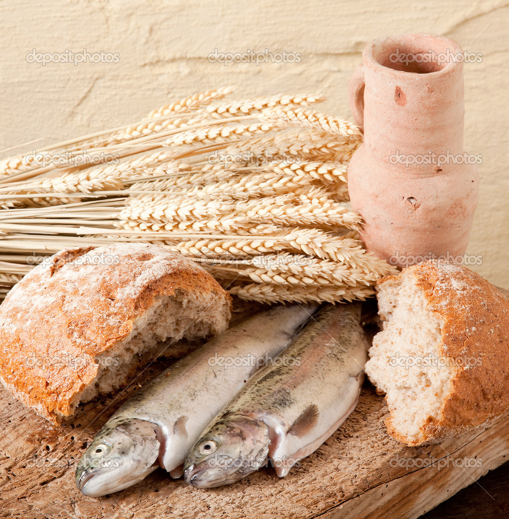 Wine, wheat, bread and fish as symbols of religion — Stock Photo #9841110