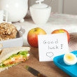 Breakfast table with good luck note — Stock Photo