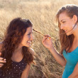 Girl friends in wheat field — Stock Photo