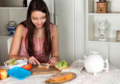 Woman making a lunchbox — Stock Photo