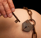 Lock on pregnant belly — Stockfoto