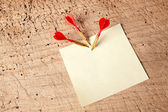 Red darts in a notepad — Stock Photo
