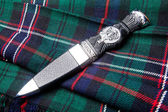 Sgian dubh on kilt — Stock Photo