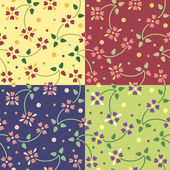 Set of seamless patterns with cute small flowers — Stock Vector