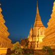 Wat Pho in Bangkok after sunset - Stock Photo
