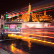 Bangkok Night Traffic - Tuk Tuk in front of the Grand Palace - Stock Photo