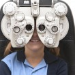 Eye test with phoropter — Stock Photo