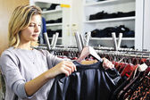 Boutique shopper with jacket — Stock Photo