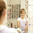 Young girl choosing new glasses — Stock Photo #9415626