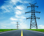 Highway and high-voltage tower — Stockfoto