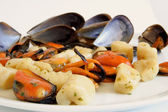 Italian food: gnocchi with mussels — Stock Photo