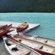 Stock Photo: Canoes on beautiful tourquoise lake