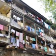 Clothes hanging on the facade of a building, India - Stock Photo