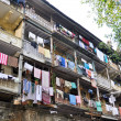 Clothes hanging on the facade of a building, India — Stock Photo