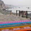 Stock Photo: Saris on the stairs in Varanasi, India.