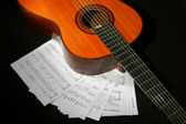Guitar and music sheet — Stock Photo
