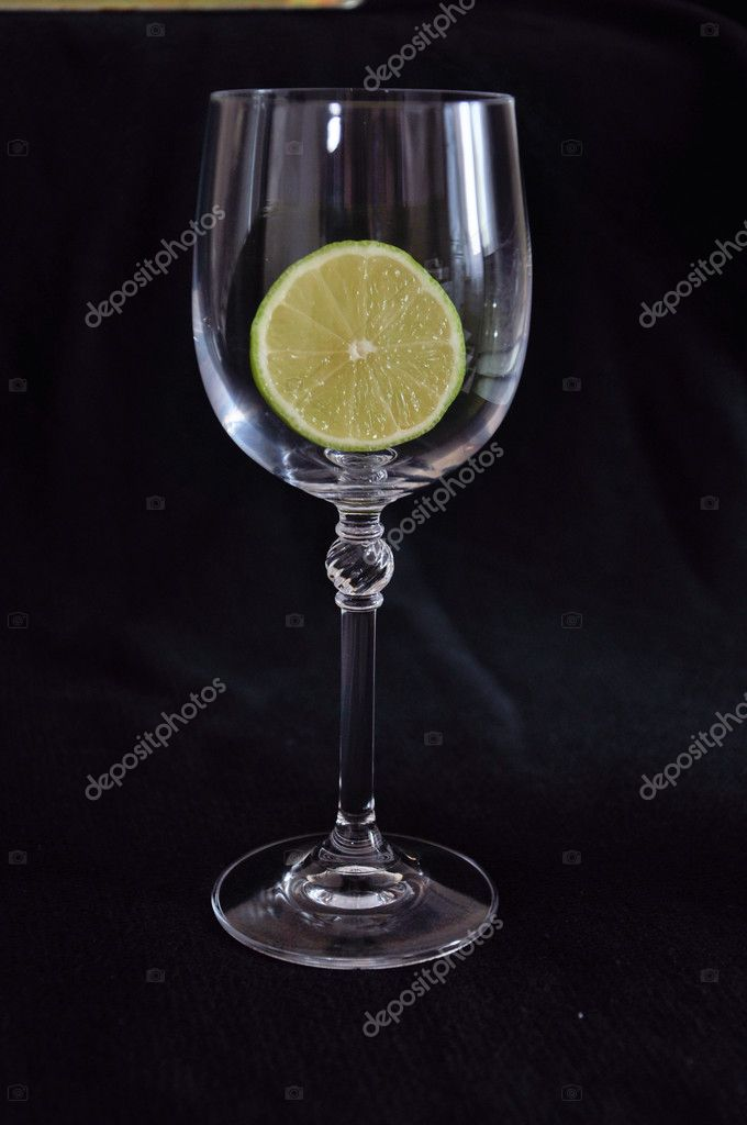 Lime in a glass on a dark background — Stock Photo #9450374
