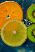 Two kiwi fruit, orange and lemon — Stock Photo