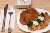Breaded chicken portion — Stock Photo