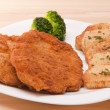 Breaded chicken fillet - Stock Photo