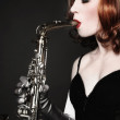 Girl with sax — Stock Photo