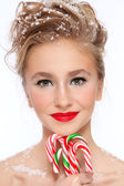 Girl with candy canes — Stock Photo