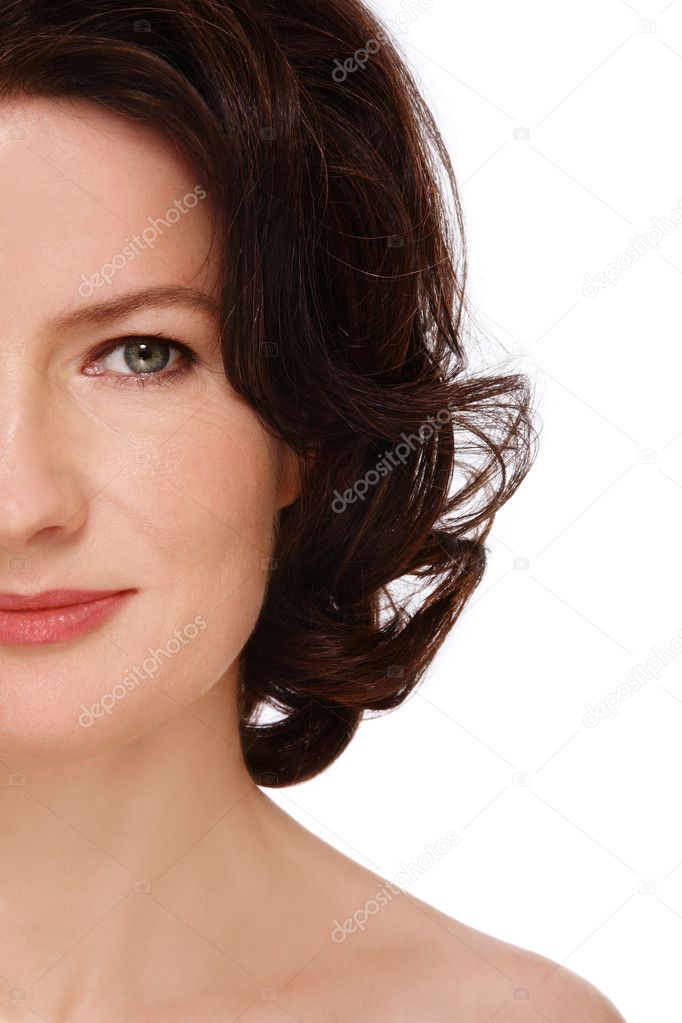 Close-up shot of attractive groomed healthy middle-aged woman on white background  Stock Photo #8786964