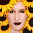 Stock Photo: Woman in sunflowers