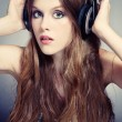 Stock Photo: Girl listening music