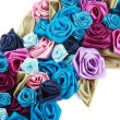 Blue, vinous, pink and turquois handmade silk roses on white background — Stock Photo #8852647