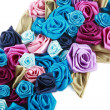 Stock Photo: Blue, vinous, pink and turquois handmade silk roses on white background
