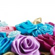 Blue, vinous, pink and turquois handmade silk roses on white background — Foto Stock