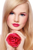 Blond girl with rose — Stock Photo