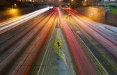 Merging Freeway traffic at night — Stock Photo
