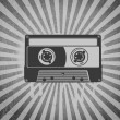 Cassette Tape over Grey Background Rays Grunge — Stock Photo #8656884