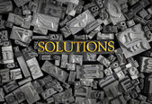 Solutions spelled out in metal letters — Stock Photo