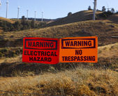 Warning signs on barb wire — Stok fotoğraf