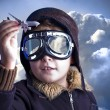 Little boy in the pilots hat. Boy as an old style pilot holding - Stock Photo