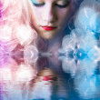 Sweet teen with colored hair, light effects in the water reflect - Stockfoto