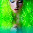 Green fairy girl head down with reflection in water — Stock Photo
