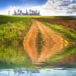 Industry over crop field with water reflection - Stock Photo