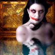 Woman vampire with blood in his mouth. Gothic Image halloween ov - Stock Photo