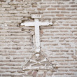 Stone cross on the wall of a church, Spain - Stock Photo