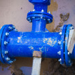 Blue pipe in the street damaged, repair - Stockfoto