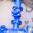 Blue pipe in the street damaged, repair - Stock Photo
