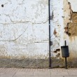 Stock Photo: Old street with rusty wall